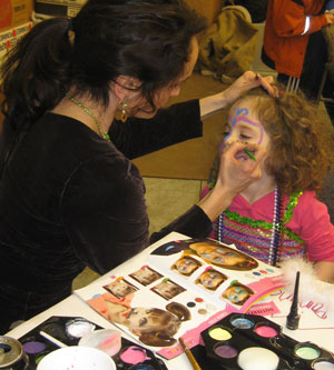 Face painting at a girls birthday party