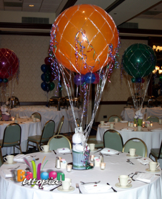 Hot air balloon centerpieces looking much like the book with a Dr. Seuss